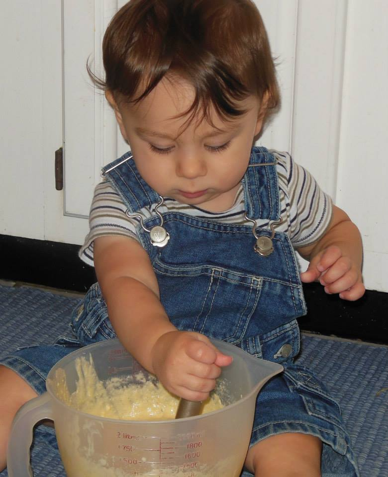 toddler helping cook